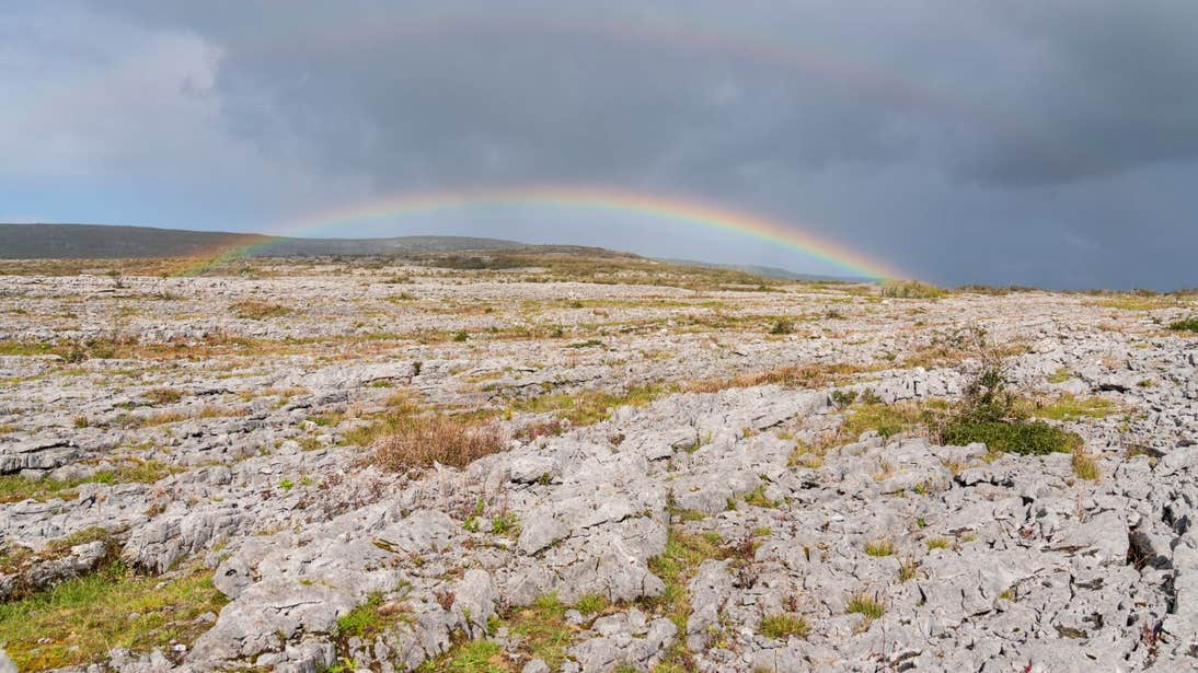 A double rainbow over the rocky landscape of The Burren, County Clare
