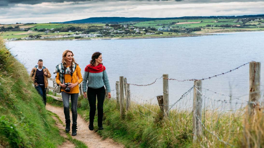 People walking along the Ardmore Cliff Walk County Waterford