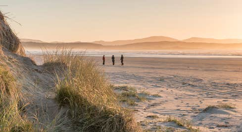 Sunset views and people walking at the beach in Co. Donegal