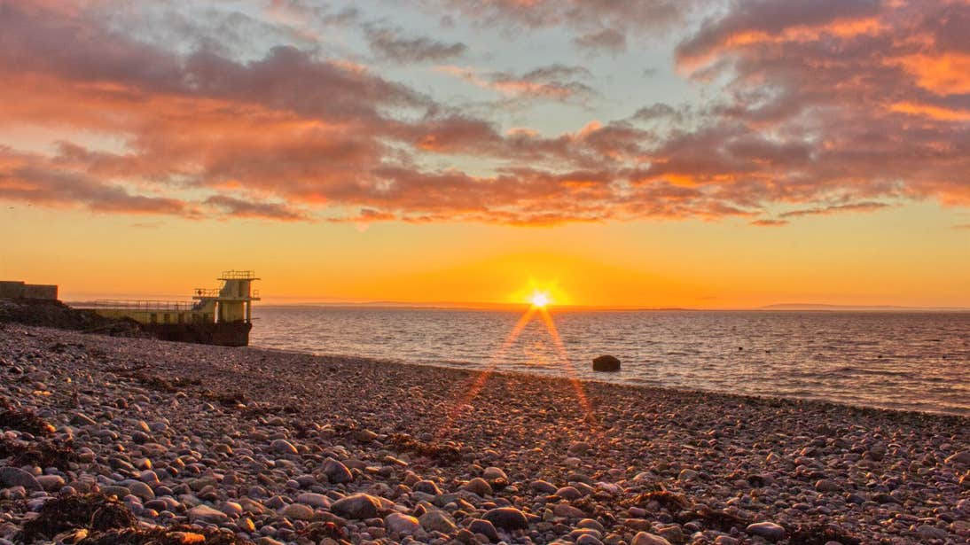Sunset at a stony beach in Salthill, Galway
