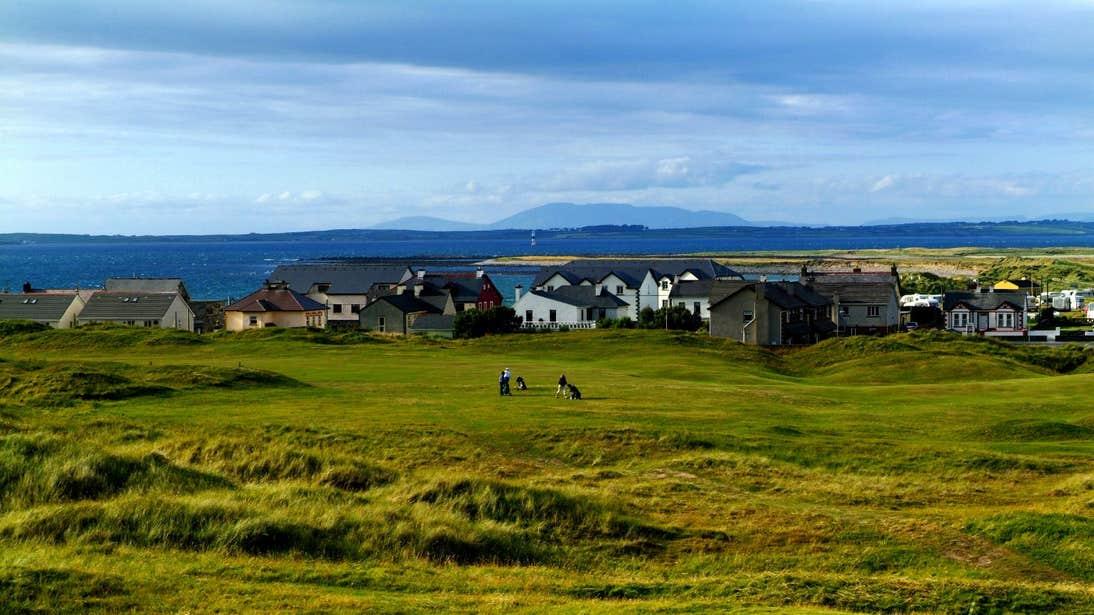 People playing a round of golf by the sea at Strandhill Golf Club, Sligo