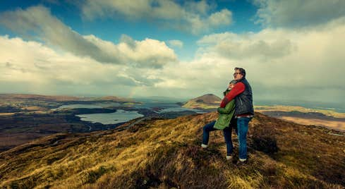 Two walkers at Diamond Hill, Connemara, County Galway