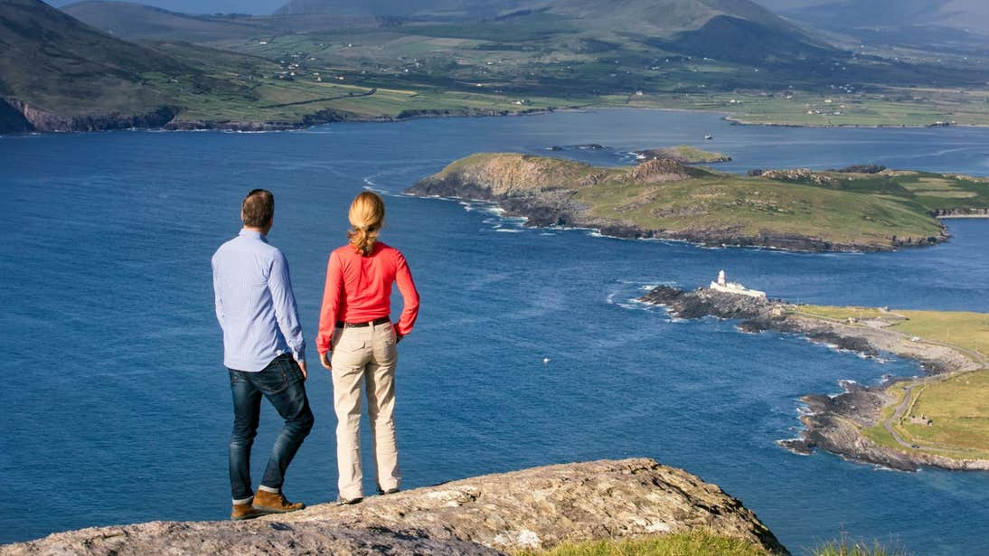 A couple looking out from the top of Geokaun Mountain, Valentia Island, Co. Kerry