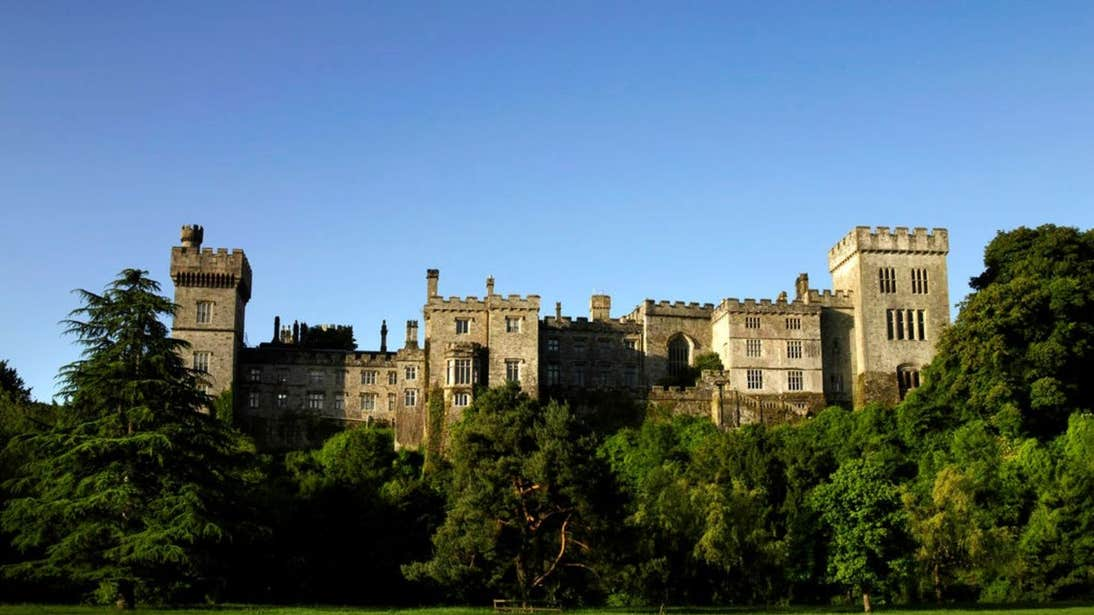 Lismore Castle in County Waterford on a sunny day under clear skies.