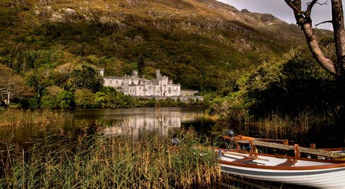A white wooden boat on the lake near Kylemore Abbey in County Galway