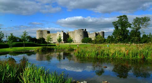 A river in front of Roscommon Castle, Co. Roscommon on a sunny day