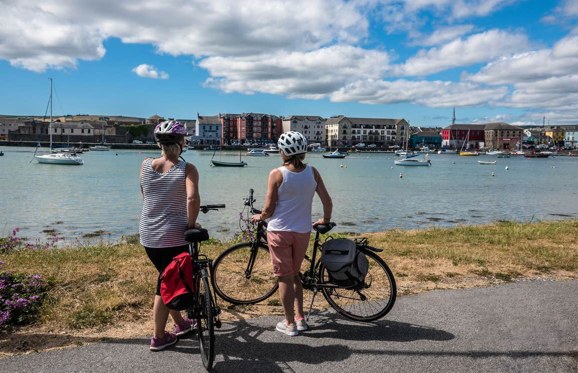 Two people looking at the city on the Waterford Greenway, County Waterford