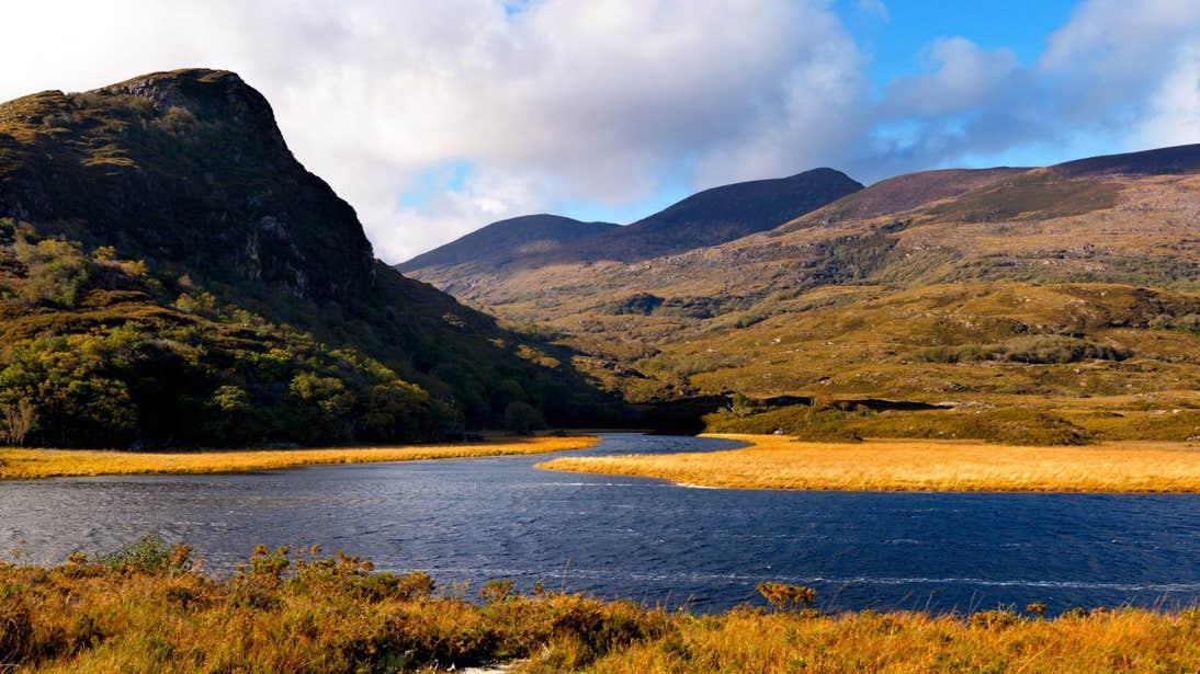 A lake near a mountain in Killarney National Park