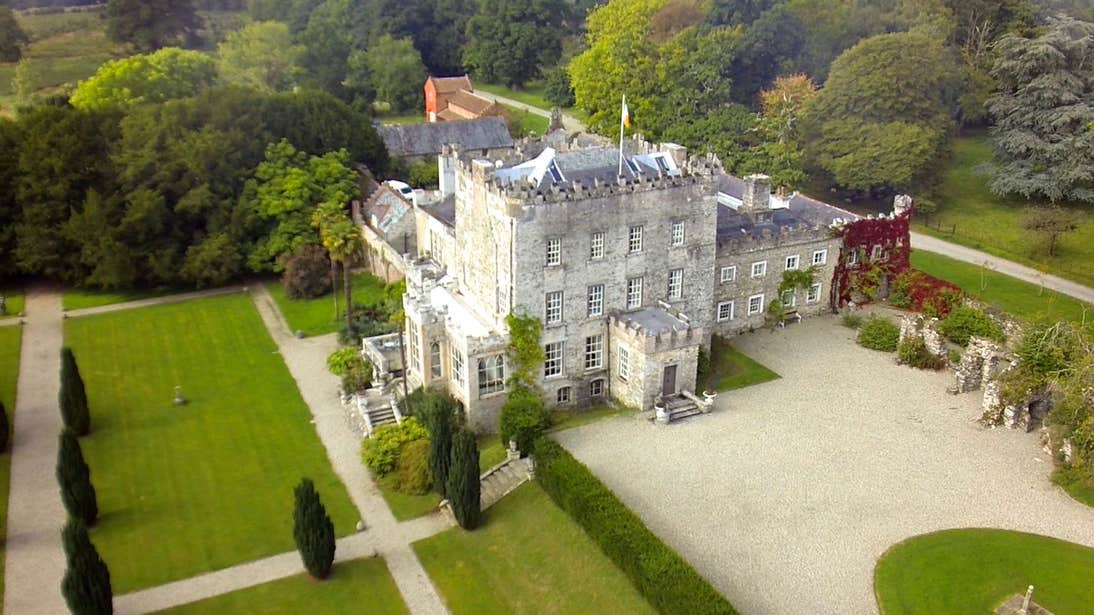 Aerial view of Huntington Castle in County Carlow surrounded by trees and lawns