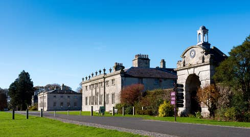 An exterior view of Russborough House, County Wicklow with blue skies and green parklands