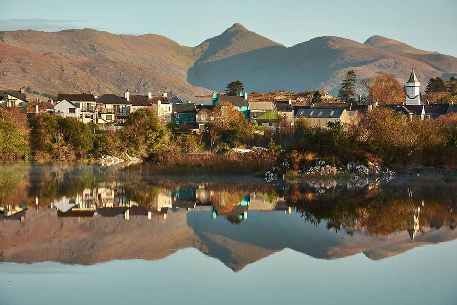 An image of houses and buildings reflected in the water at Sneem, Co. Kerry
