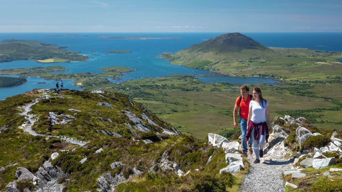Two groups of people hiking to the lookout point on Diamond Hill Loop, County Galway