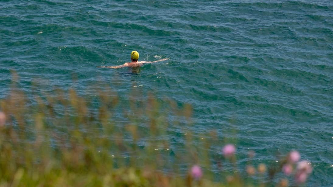 Person swimming in the sea at Brittas Bay in Wicklow