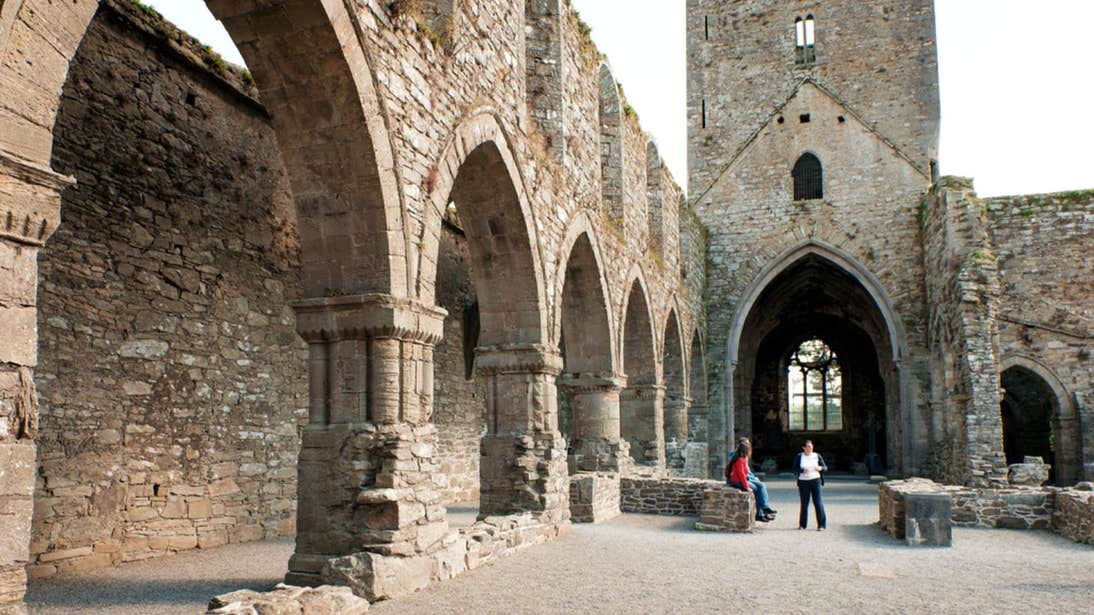 People sitting in the ruins of Jerpoint Abbey, Kilkenny