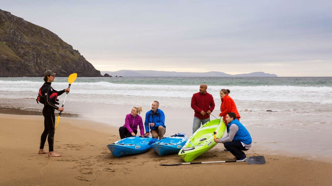 A group of people learning how to kayak in Dingle, Co. Kerry