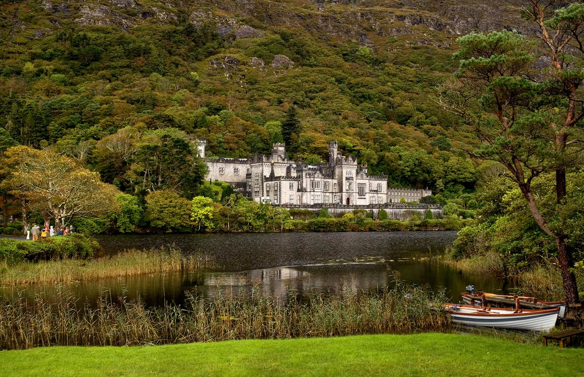 Kylemore Abbey, Connemara, County Galway beside a lake and surrounded by trees