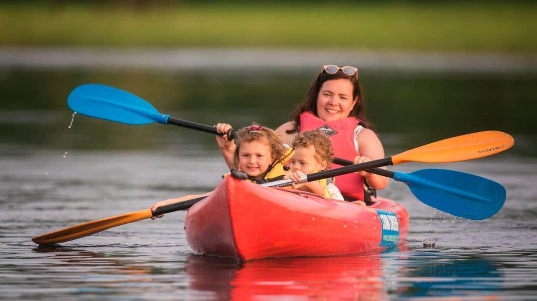 Woman and children kayaking in Lough Oughter, Cavan
