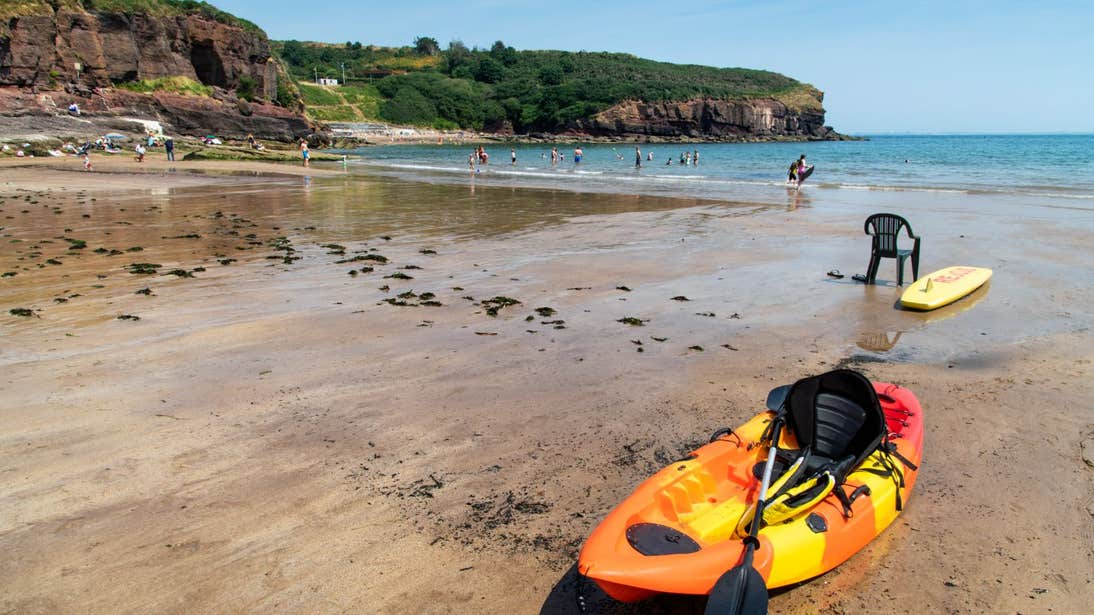 A kayak beside the water at Dunmore East Beach, Waterford