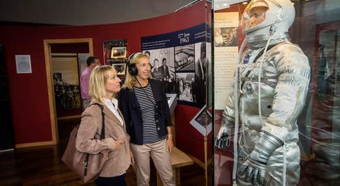 Two women looking at an exhibition at The Kennedy Homestead in County Wexford.
