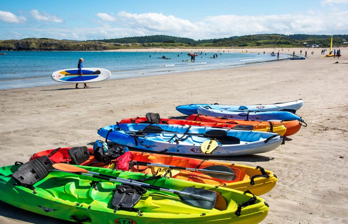 Colourful kayaks on the sand at Marble Hill Beach, Co Donegal