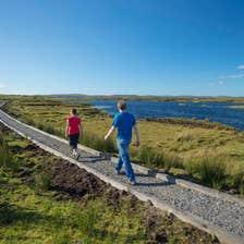 Image of people on Derrigimlagh Loop Walk, Connemara, County Galway