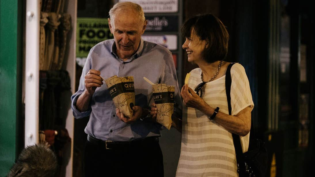 Two people eating fish and chips in Killarney, Kerry