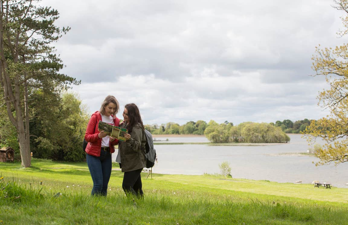 Two people exploring the grounds of Belvedere House, Westmeath