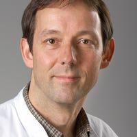 Dr.    Loh