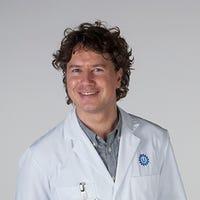 Dr.   Stecher