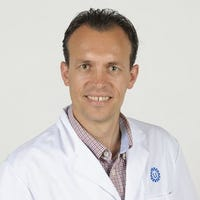 Dr.    Takken