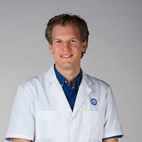 Dr.   Versteylen