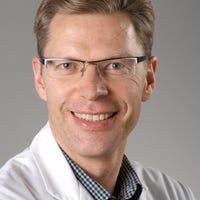 Dr.    Meine